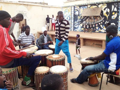 Watching a local Djembe & Dance group practice in Senegal