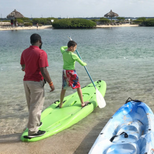 Hawks Cay Resort child paddle boarding