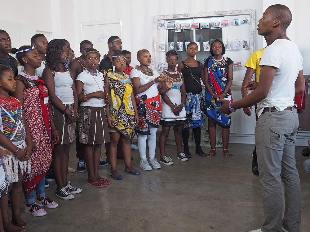 The Eza Kwantu Cultural Group performs at The Heart of a Woman Project First Anniversary Cultural Celebration and Photography Exhibition. Eza Kwantu is a local youth group of vocalists that sing in isiXhosa.