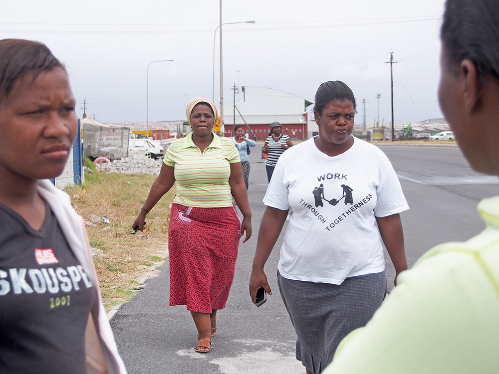 Participants walk back to the van after a day of photographing Township Life for the postcard image.