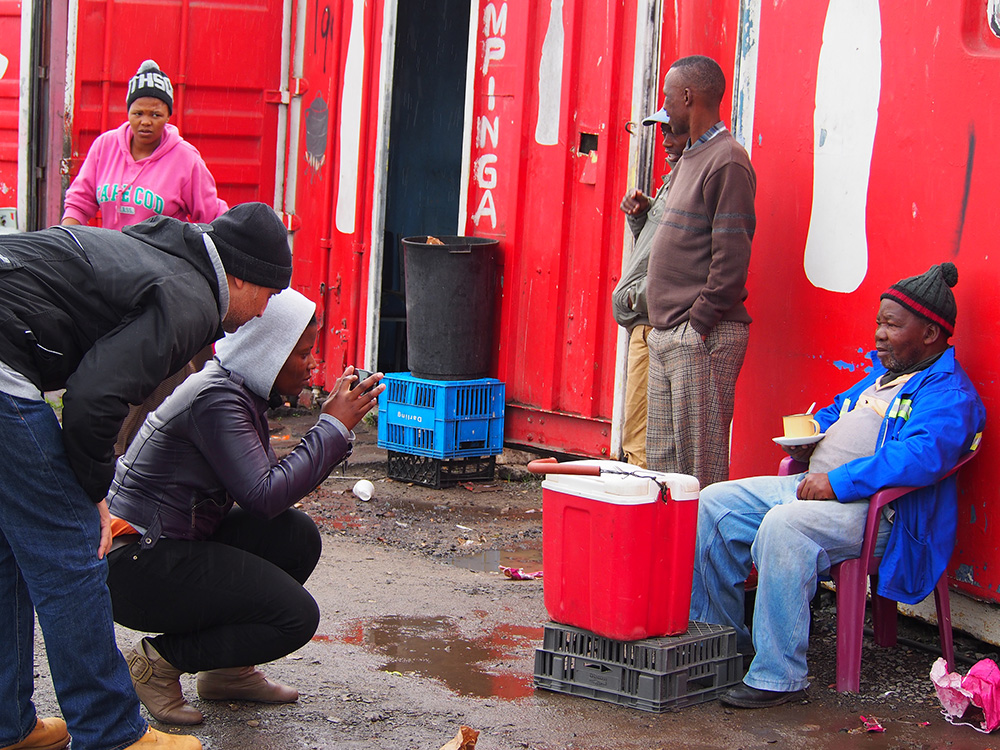 Nwabisa Ndongeni a mother of 2, photographs Henry at the Site C taxi rank in Khayelitsha as Thoban Joppie, a member of the Cape Town Instagram community offers some tips. On June 1, 2014, the women hosted the inaugural #InstameetEKASI in Khayelitsha with members of the Cape Town Igers (instagrammers). It was wonderful to see these two communities come together in their mutual love of mobile photography and Instagram. The ladies enjoyed their time, appreciated the tips and look forward to another InstameetEKASI.