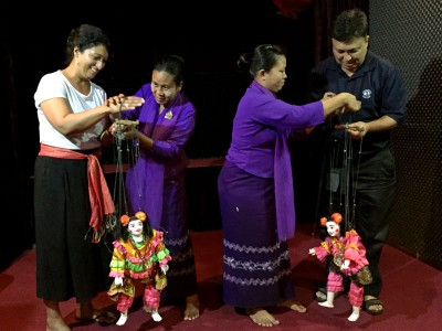 My cousin and father trying their hand at puppetry at the Htwe Oo Myanmar puppet show in Yangon, Myanmar.
