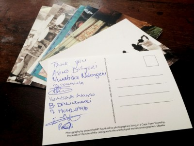 Signed postcards to donors and buyers